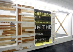 "Daniela Brahm Community, 2006 wooden structure, paint, ""Proclamation Poster / freedom"", oil on primed paper"