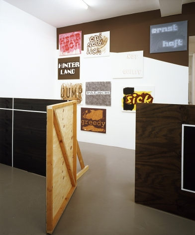 "Daniela Brahm Hinterland, 2002 Mirko Mayer Gallery, Cologne ""Hiding"", wooden fence, 120 x 750 cm paintings from the series ""difficult characters"", oil on canvas, 60 x 70 cm each, emulsion on wall"