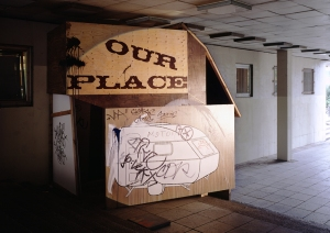 """Daniela Brahm Recycling Utopia, 2006 a hut in a public passageway build out of the paintings remaining from the installation """"The New Town"""" in Zamosc, approx. 3.3 x 3.5 x 2.5m"""